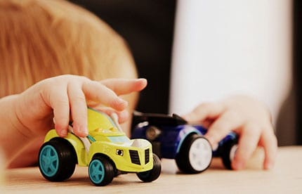 A child playing with cars